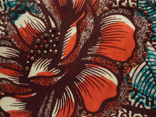 Burnt Orange Ankara print clutch- flower detail